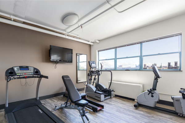 fitness center at Honeyman Hardware Lofts