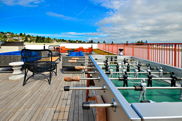 rooftop games at Aura West Seattle Apartments
