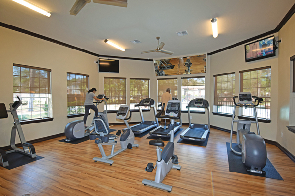 fitness center at The Villages of Cypress Creek Apartments