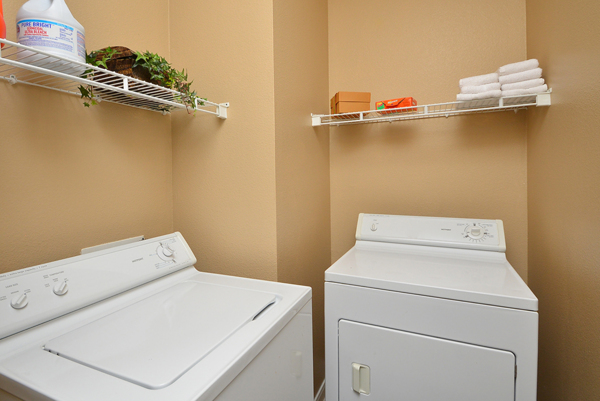 laundry room at The Villages of Cypress Creek Apartments