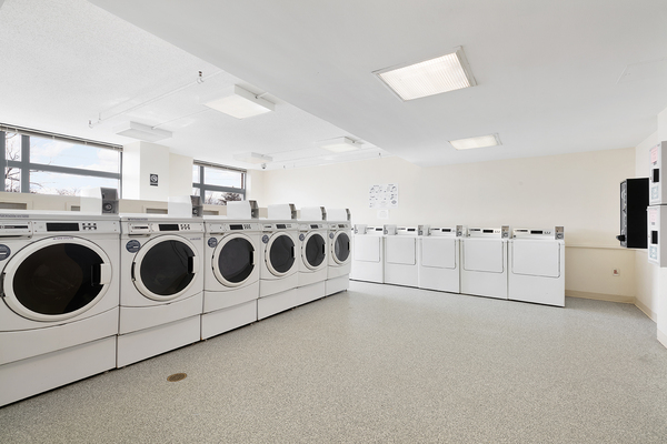 laundry center at SoCam 290 Apartments