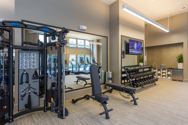 fitness center at Alexan 5151 Apartments