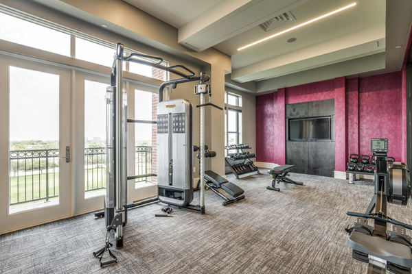 fitness center at The Ivy River Oaks Apartments