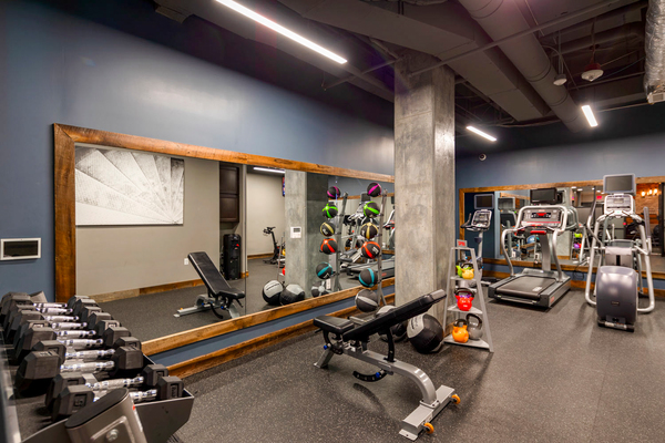 fitness center at The Aspen Apartments