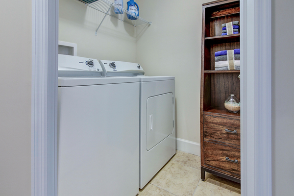 laundry room at Bridges at Kendall Place Apartments
