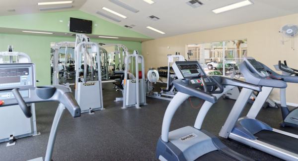 fitness center at Finisterra Apartments