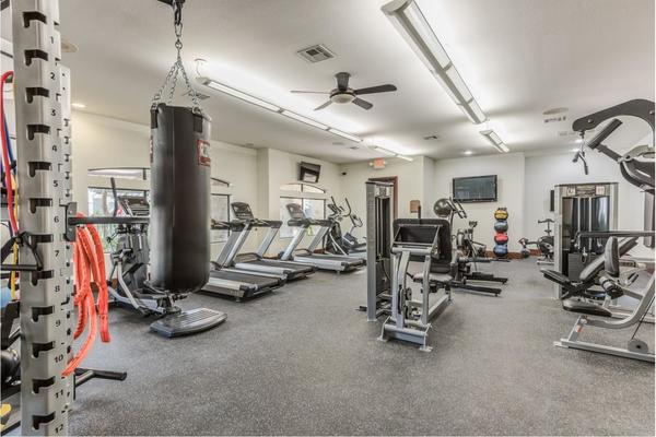 fitness center at Deseo at Grand Mission Apartments