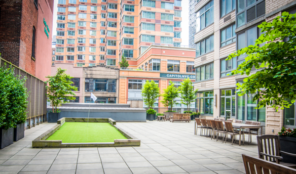 putting green at 800 Sixth Apartments