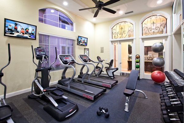 fitness center at St. Claire Apartment Homes