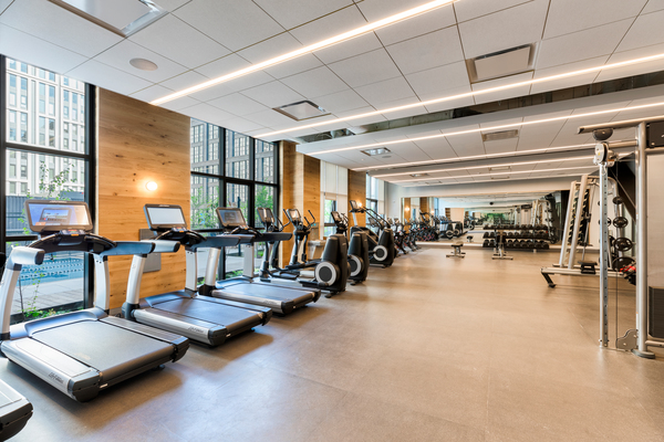 fitness center at The Girard Apartments