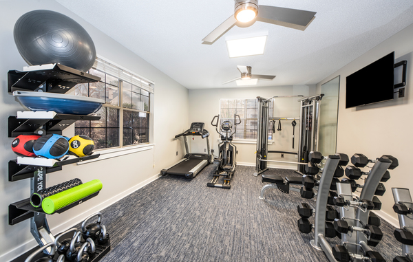 fitness center at The Whitley Apartments