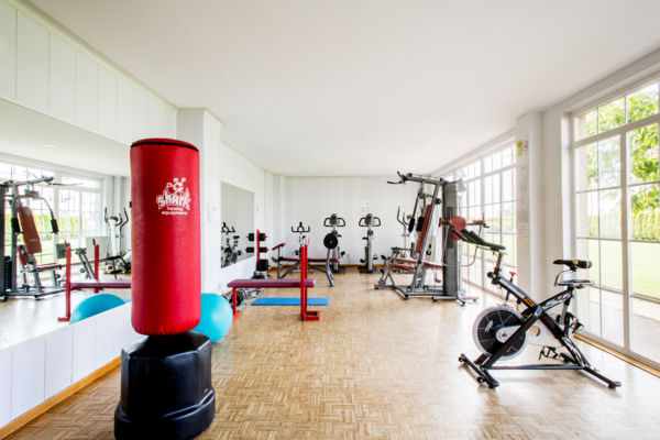 fitness center at Siglo XXI Residence Hall