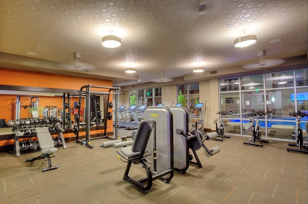 fitness center at Alara Uptown Luxury Apartments